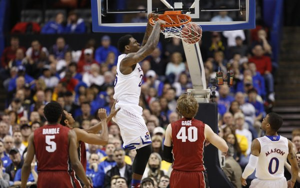 Kansas forward Tarik Black delivers on a dunk over the Stanford defense during the second half on Sunday, March 23, 2014 at Scottrade Center in St. Louis.
