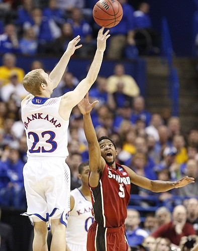 Kansas guard Conner Frankamp puts up a three over Stanford guard Chasson Randle to get the Jayhawks within two points with less than a minute remaining on Sunday, March 23, 2014 at Scottrade Center in St. Louis.
