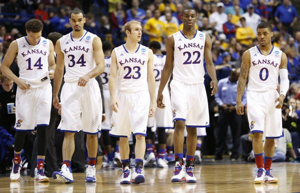 Kansas players Brannen Greene, left, Perry Ellis, Conner Frankamp, Andrew Wiggins and Frank Mason come out for their final possession after a timeout on Sunday, March 23, 2014 at Scottrade Center in St. Louis.