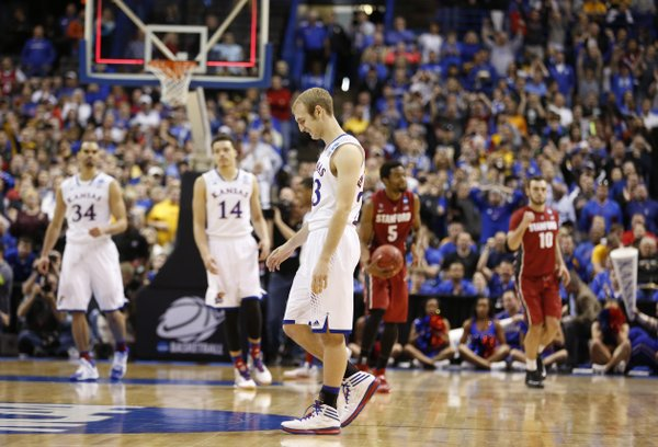 Kansas guard Conner Frankamp walks off the court after missing a three with seconds remaining against Stanford on Sunday, March 23, 2014 at Scottrade Center in St. Louis.