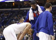 Kansas center Joel Embiid consoles Perry Ellis during the Jayhawks' third-round loss to Stanford on Sunday, March 23, 2014, at the Scottrade Center in St. Louis.