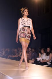 A model wears a dress with lace overlay and bold pattern by 17-year-old designer Kate Walz at Kansas City Fashion Week.