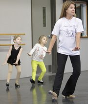 Dance instructor Karen Fender leads two young tap dancers through lessons recently. Fender will be retiring this spring after decades at the helm of Lawrence's Dance Gallery, 4940 Legends Drive, where she has trained numerous dancers.