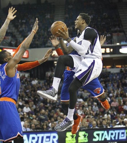 Sacramento Kings guard Ben McLemore, right, drives to the basket against New York Knicks defender Tim Hardaway Jr. left, during the second half of an NBA basketball game in Sacramento, Calif., on Wednesday, March 26, 2014.The Knicks won 107-99.(AP Photo/Steve Yeater)