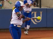 Kansas senior Ashley Newman makes contact for a single in the first inning of Kansas' game against Oklahoma State, Friday at Arrocha Ballpark.
