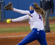 Kansas sophomore pitcher Kelsey Kessler winds up as she delivers a pitch during Kansas' game against Oklahoma State, Friday at Arrocha Ballpark.