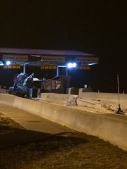 One person died and another is in critical condition after a tractor-trailer hit a tollbooth on the Kansas Turnpike in Leavenworth County about 3 a.m. Saturday.