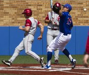 Oklahoma's Hunter Haley, left, scores on a wild pitch as Kansas senior pitcher Frank Duncan (19) is unable to handle the ball during the final game of Kansas' three game series against Oklahoma, Sunday afternoon at Hoglund Ballpark. The Jayhawks defeated the Sooners, 4-3, and with the victory they avoided a series sweep by Oklahoma.