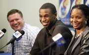 Kansas guard Andrew Wiggins laughs with Jayhawks' head coach Bill Self after Self made a joke about how he could still come back during a news conference in which Wiggins declared his intention to enter the NBA Draft on Monday, March 31, 2014 at Allen Fieldhouse. To his right is his mother Marita Wiggins.