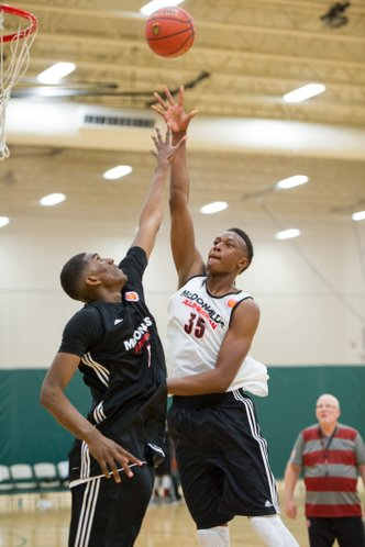 Myles Turner, a 7-foot center from Trinity High, in Bedford, Texas, and the only uncommitted player participating in the McDonald's All-American game, takes a jump-hook during practice on Sunday in Chicago — three days before the McDonald's All American Game.