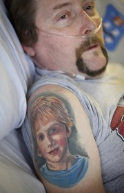 On David Jensen's right shoulder is a tattoo of his 8-year-old son Isaac Hartz-Jensen. Jensen says he and his son often talk about the things they will do together after his transplant.