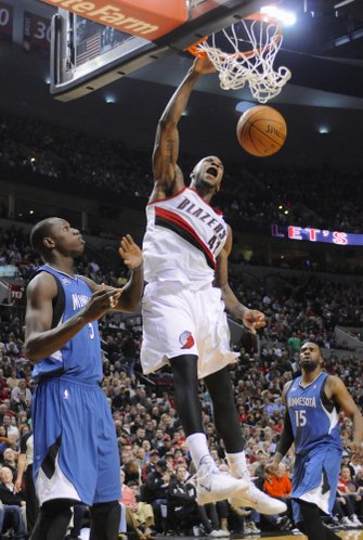 Portland Trail Blazers' Thomas Robinson (41) scores against Minnesota Timberwolves' Gorgui Dieng (5) during the second half of an NBA basketball game in Portland, Ore., Sunday, Feb. 23, 2014. The Trail Blazers won 108-97. (AP Photo/Greg Wahl-Stephens)