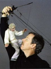 Joseph Cashore with one of his marionettes.