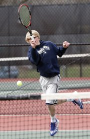 Bishop Seabury sophomore Thomas Bach makes a hard return in a tennis match Friday against Lawrence High on Friday, April 4, 2014.