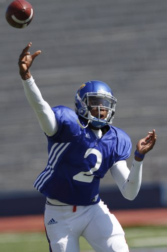 Kansas quarterback Montell Cozart throws during drills during a KU football practice Saturday, April 5, 2014, at Memorial Stadium.