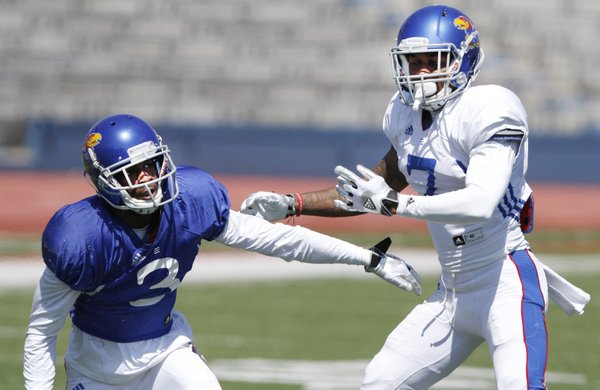 Kansas wide receiver Tony Pierson, (3) goes against cornerback Kevin Short (7) in drills during a KU football practice Saturday, April 5, 2014, at Memorial Stadium.