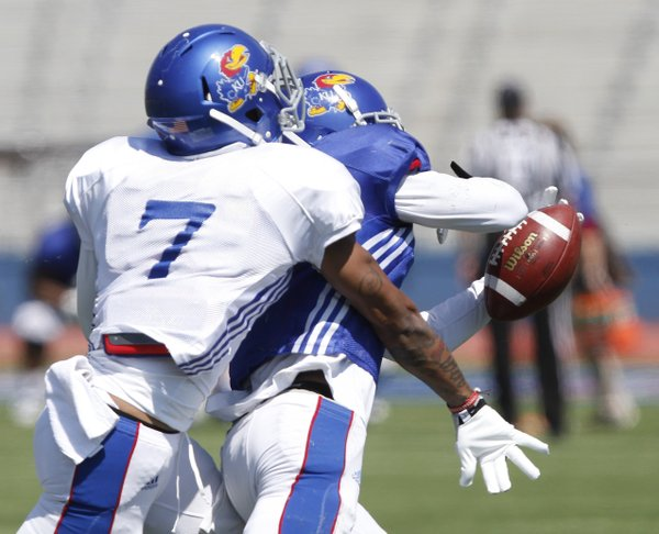 Kansas cornerback Kevin Short (7) knocks the ball loose from a receiver during a KU football practice Saturday, April 5, 2014, at Memorial Stadium.