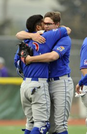 Kansas University pitcher Frank Duncan, right, gets a hug from catcher Ka'iana Eldredge after striking out the final batter in Duncan's complete-game victory on Sunday, April 6, 2014, in Manhattan.