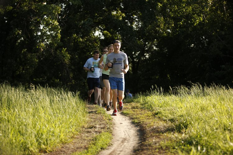 Members of the Lawrence Trailhawks run along the North River Trail in May 2012. The trail is literally in Lawrence's backyard and provides a variety of terrain for all levels of runner.