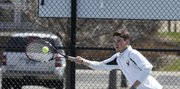 Free State senior Stephen Anderson reaches out for a forehand during the Firebirds' quad on Tuesday, April 8, 2014, at FSHS.