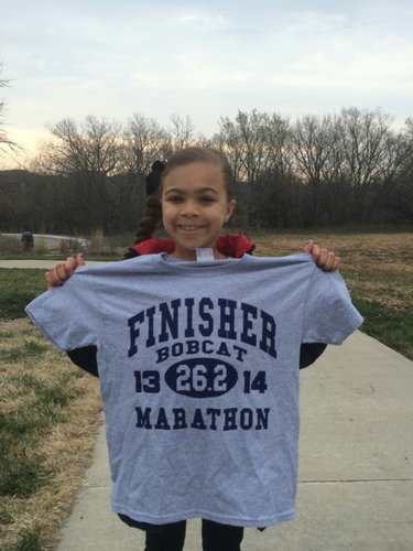 Ivori looking stylish in her finisher shirt