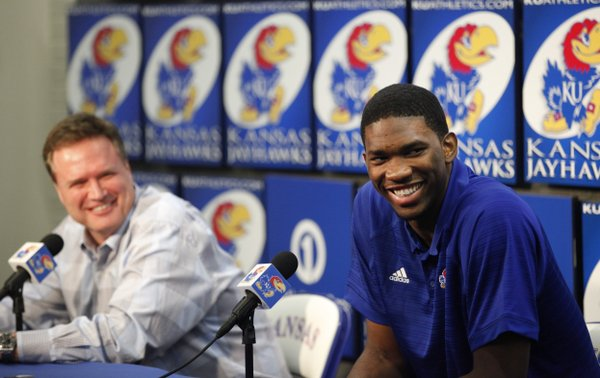 Kansas center Joel Embiid smiles along side head basketball coach Bill Self as he talks with media members during a news conference on Wednesday, April 9, 2014 at Allen Fieldhouse in Lawrence, Kan. Embiid announced his intention to enter the 2014 NBA Draft. (AP PHOTO/Nick Krug/Lawrence Journal-World)