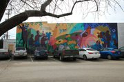 Spencer Museum of Art and a Lawrence-based development group tentatively agreed to have artist Dave Loewenstein recreate his Pollinators mural. The building that it's currently on is scheduled to be torn down and a multi story building will be built in its place.