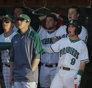 Free State's Cooper Karlin, right, other others on the Firebirds' bench react to a sacrifice fly by teammate Ryan Cantrell during the fourth inning against Shawnee Mission West, Thursday, April 10, 2014 at Free State High School.