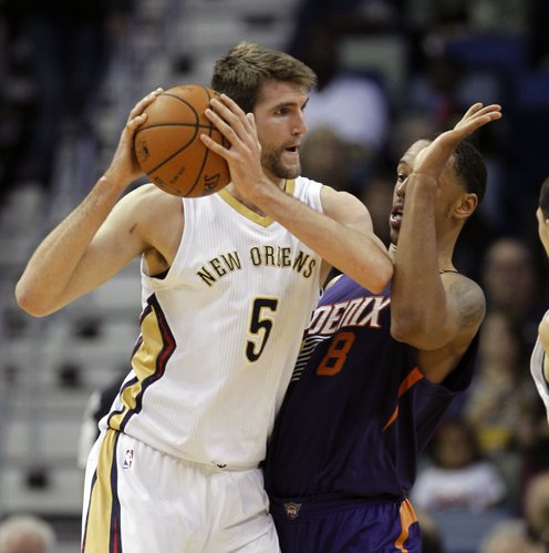 New Orleans Pelicans center Jeff Withey (5) tries to get around Phoenix Suns forward Channing Frye (8) in the first half of an NBA basketball game in New Orleans, Wednesday, April 9, 2014. (AP Photo/Bill Haber)