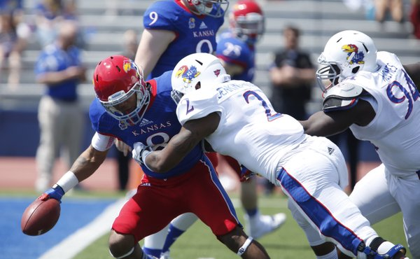 Blue Team receiver Nick Harwell is tackled for a loss by White Team defenders Marcus Jenkins-Moore and Tyler Holmes during the first half of the Kansas Spring Game on Saturday, April 12, 2014 at Memorial Stadium. Nick Krug/Journal-World Photo