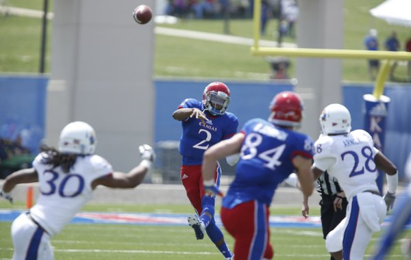Blue Team quarterback Montell Cozart throws against the White Team during the first half of the Kansas Spring Game on Saturday, April 12, 2014 at Memorial Stadium. Nick Krug/Journal-World Photo