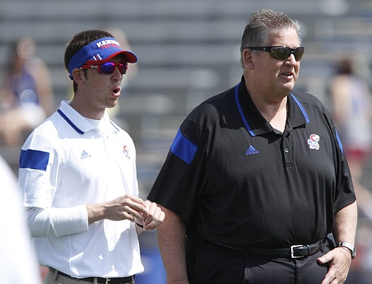 Head coach Charlie Weis watches warmups with his son Charlie Weis Jr. on Saturday, April 12, 2014 at Memorial Stadium. Nick Krug/Journal-World Photo
