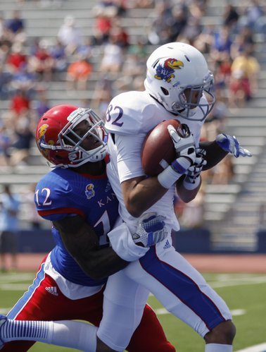 White Team receiver Andrew Turzilli (82) catches a touchdown pass against Blue Team cornerback Dexter McDonald (12) during half of the Kansas Spring Game on Saturday, April 12, 2014 at Memorial Stadium. Nick Krug/Journal-World Photo