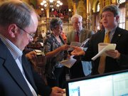 Members of the Kansas Senate discuss whether the chamber's rules allow a debate on a school funding plan before ultimately permitting the discussion to go forward, Sunday, April 6, 2014, at the Statehouse in Topeka, Kan. They are from left to right, Senate Minority Leader Anthony Hensley, a Topeka Democrat; Senate President Susan Wagle, a Wichita Republican; Sen. Tom Arpke, a Salina Republican, and Senate Vice President Jeff King, an Independence Republican.