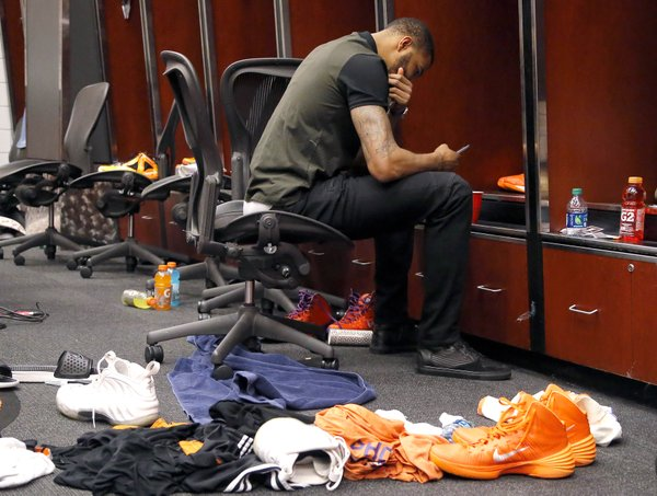 Phoenix Suns' Markieff Morris sits in the locker room after an NBA basketball game against the Memphis Grizzlies, Monday, April 14, 2014, in Phoenix. The Grizzlies won 97-91 eliminating the Suns from the playoffs. (AP Photo/Matt York)