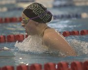 Free State's Kate McCurdy comes up for a breath of air in the 200-yard IM in the Free State Invitational on Tuesday, April 15, 2014, at FSHS.