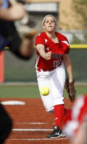 Lawrence High's Megan Sumonja delivers a pitch against Olathe South in a doubleheader Tuesday at LHS.