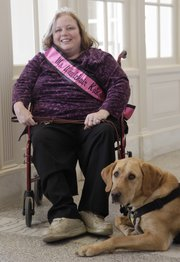 Ms. Wheelchair Kansas' Bridgid Schwilling with her service dog Grady.