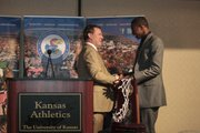 "Kansas University men's basketball coach Bill Self, left, congratulates freshman guard Andrew Wiggins during the Jayhawks' postseason awards banquet Tuesday, April 15, 2014, at the Lawrence Holiday Inn. Wiggins received the 2014 Danny Manning ""Mr. Jayhawk"" Award after leading KU's Big 12 championship team in scoring during his one-and-done season."