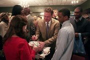 Kansas University men's basketball coach Bill Self signs a basketball for a fan after the Jayhawks' postseason awards banquet, Tuesday, April 15, 2014, at the Lawrence Holiday Inn.