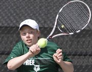 Free State tennis player Tucker Nickel returns a shot in his No. 6 singles match Wednesday against Washburn Rural at FSHS.