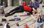 Lawrence High junior Sean McCoy makes an attempt to clear the bar during the pole vault event of the LHS Invitational on Wednesday, April 16, 2014 at Lawrence High School.