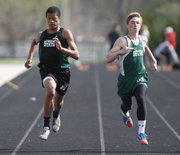 Free State runners Nichalus Williams, left, and Nathan Thomas compete in the final heat of the Boys 100 Meter event during the LHS Invitational on Wednesday, April 16, 2014 at Lawrence High School.