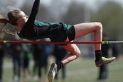 Free State freshman Natalie Clarke makes an attempt at clearing the bar while competing in the girls high jump event of the LHS Invitational on Wednesday, April 16, 2014 at Lawrence High School.