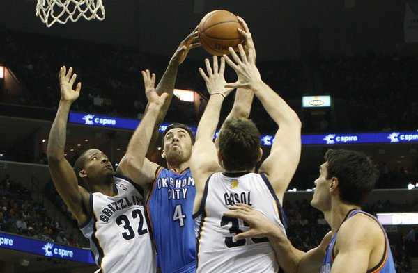 Oklahoma City Thunder forward Nick Collison (4) goes to the basket against Memphis Grizzlies forward Ed Davis (32) and center Marc Gasol (33), of Spain, in the first half of an NBA basketball game, Tuesday, Jan. 14, 2014, in Memphis, Tenn. (AP Photo/Lance Murphey)