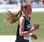Free State's Emily Venters runs during qualifying for the 3200-meter run at the Kansas Relays on Friday, April 18, 2014, at Rock Chalk Park.