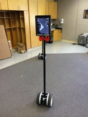 "Administrators practice using a telepresence robot at Lawrence Virtual High School, 1104 E 1000 Rd. Two of the robots, owned by Lawrence Public Schools, were used to allow out-of-state students to ""attend"" the LVHS prom on Saturday, April 12."