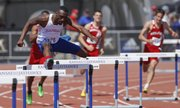 Kansas hurdler Michael Stigler glances over at the crowd as he clears a hurdle during the Mens 400 Meter Hurdles event of the Kansas Relays on Saturday, April 19, 2014 at Rock Chalk Park. Nick Krug/Journal-World Photo