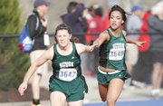Free State's Gabbi Dabney hands off to Brogan Scott during the Girls 1600 Sprint Medley Relay event of the Kansas Relays on Saturday, April 19, 2014 at Rock Chalk Park. Nick Krug/Journal-World Photo