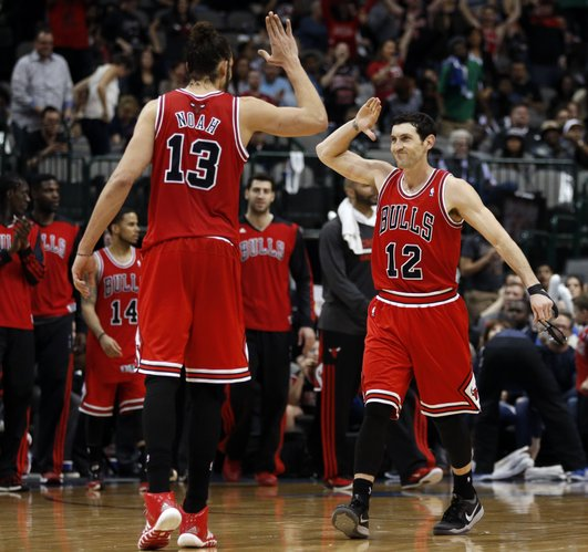 Chicago Bulls center Joakim Noah (13) and guard Kirk Hinrich (12) celebrate at the end of the team's 100-91 comeback win over the Dallas Mavericks in an NBA basketball game on Friday, Feb. 28, 2014, in Dallas. (AP Photo/John F. Rhodes)